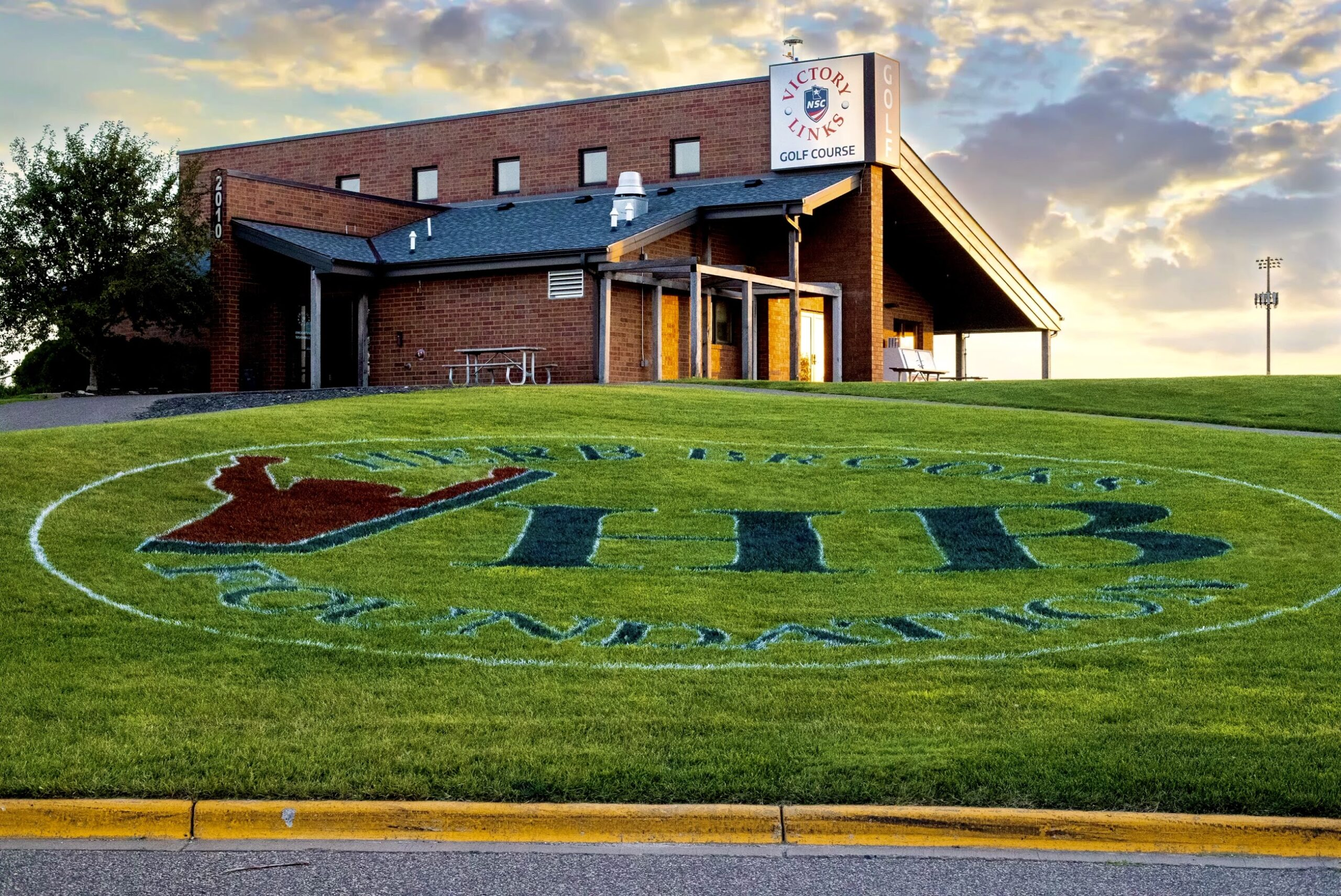 The Herb Brooks Foundation (HBF) logo was painted in grass leading to the Victory Links Clubhouse for the annual HBF Golf Classic.